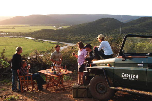 Guests enjoying sundowners in a scenic location.