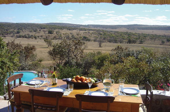 Dining with spectacular views at Kololo Game Reserve.