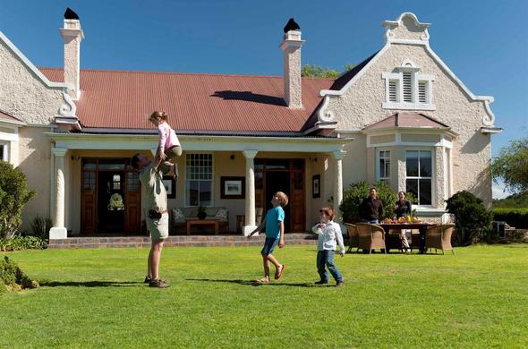 Family playing outside the Uplands Homestead.
