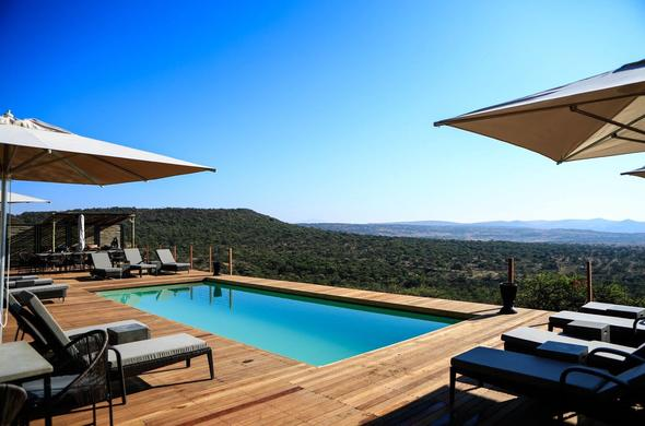 Nambiti Plains Private Game Lodge has a swimming pool with scenic views.