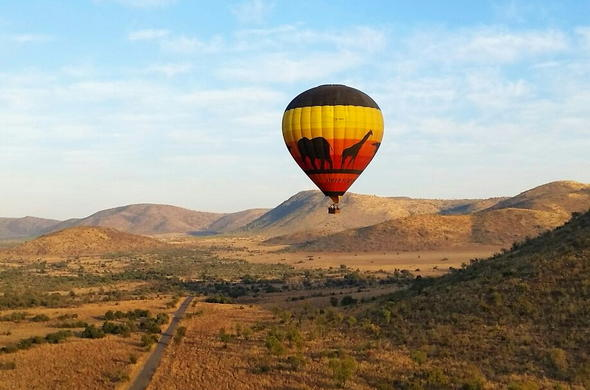 A view of a hot air balloon over the Pilansberg Game Reserve.