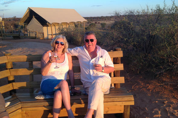 Couple relaxing with drinks at Ta Shebube Polentswa.
